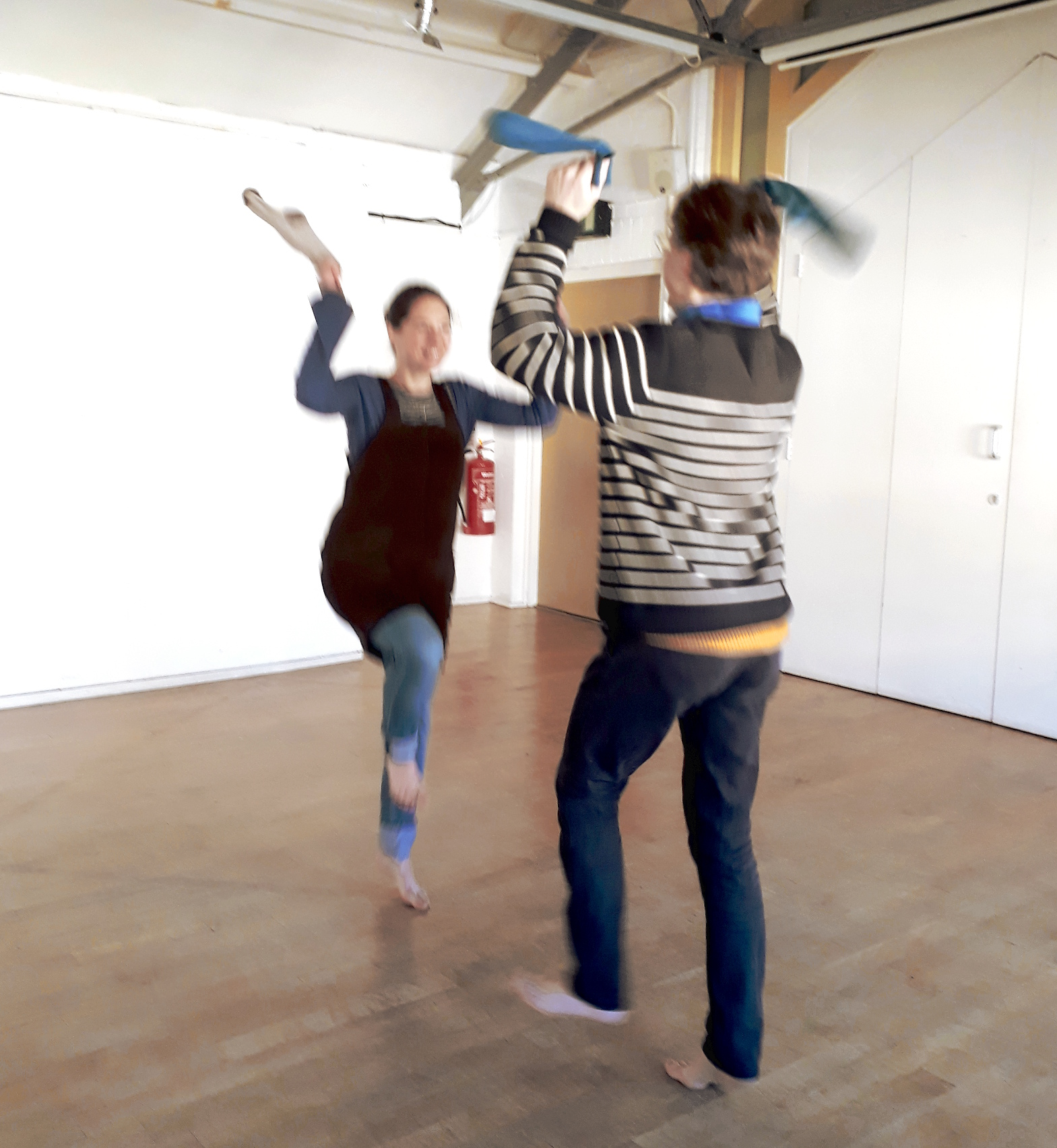 Naomi and Andrew, Morris dancing using socks as handkerchiefs on 8 November 2017 at Creative Lab, Oxford Playhouse.