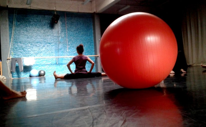 Warming-up in Hybrid Studios before the training session. There were a few large physio balls kept in the studio with which we played.