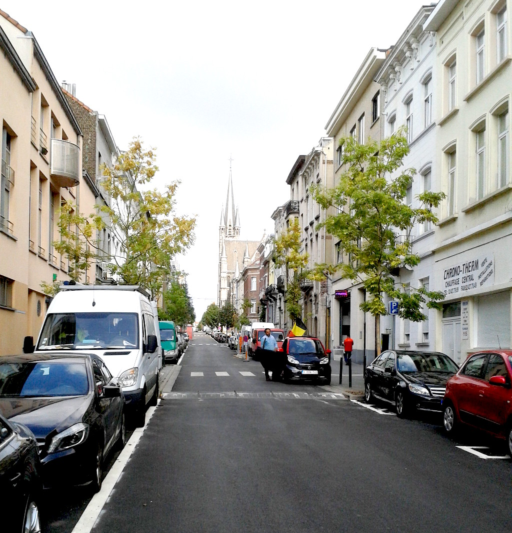 The street where Hybrid Studios is located – rue de l'Intendant 111. The church at the top of the hill is the catholic church of Église Saint-Rémi. Hybrid studies is to the right side and not visible in the photo .