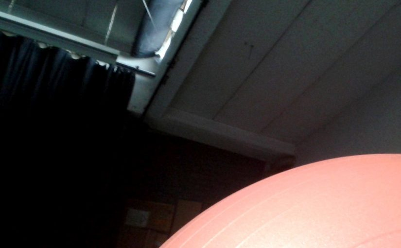 Looking to the ceiling of Hybrid Studios with a physio ball in the foreground.